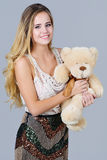 Fancy woman hugs bear toy Royalty Free Stock Image