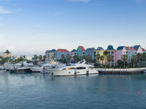 Fancy yacht marina. Luxury yachts moor at the marina of the tropical resort town Stock Photo