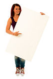 Fancy young woman holding a white banner. Portrait of a fancy young woman holding a white banner with lots of space for your text against a perfect white studio Stock Image