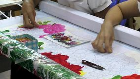 Fancywork of Vietnam women embroiderers stock video