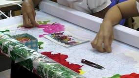 Fancywork of Vietnam women embroiderers stock video