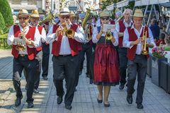 Fanfare singers, ethnic Germans, playing at musical instruments. TIMISOARA,ROMANIA-JUNE 16,2019:Fanfare singers, ethnic Germans, playing at musical instruments stock image