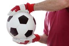 Fangen eines ledernen Balls lizenzfreies stockbild