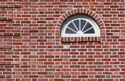 Fanlight Window in Historic Home. Fanlight window in historic house showing brick relief detail, bull-header arched lintel and sill, with overall header and stock image
