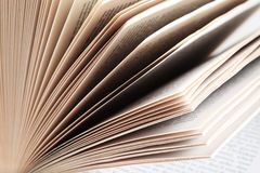 Fanned book pages closeup. Closeup of fanned pages from a paperback book Stock Image