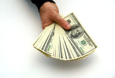 Fanned cash. Man holding large stack of hundred dollar bills fanned out Stock Photos