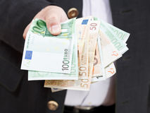 Fanned euro banknotes in male hands Stock Photography