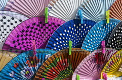 Fanned. Multicolored fans sunbathing at the flea market Royalty Free Stock Photography