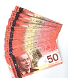 Fanned out Canadian fifty dollar bills. Fanned out new Canadian fifty dollar bills Stock Photos