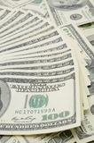 Fanned out US one hundred dollar bills. Focus on the 100 Stock Photos