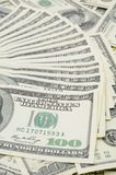 Fanned out US one hundred dollar bills. Focus on the 100 Stock Photo