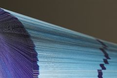 Fanned pages. The cutting face of a phone directory with fanned pages royalty free stock photo