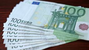 Fanned Pile of Hundred Euro Banknotes on a Table. Close-up shot Stock Images