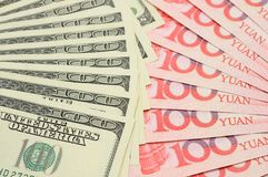 Fanned US dollar and China yuan Royalty Free Stock Image