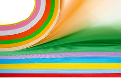 Fanning paper. Fanning through a ream of coloured paper with motion blur on the cream and green sheets Royalty Free Stock Images