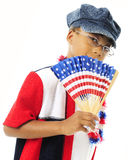 Fanning Young US Patriot. A young elementary girl finning herself and dressed in red, white and blue.  On a white background Stock Images