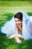 Fanny bride on the grass Stock Photos