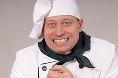 Fanny chef. Funny portrait of a cook on a gray background Royalty Free Stock Photos