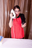 Fanny expression of housewife with cell phone and Stock Images