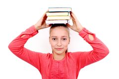 Fanny girl with four books on head Stock Photos