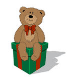 Funny vector cartoon teddy bear with bow sitting on the gift box. Funny cartoon teddy bear with bow sitting on the gift box. Vector illustration Stock Images
