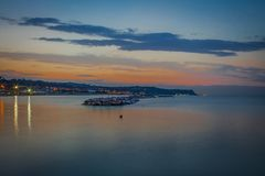 Fano, Italy. Sunset seen from the seafront,. Beautifull wiew from Fano to Pesaro in a warm evening summer royalty free stock images