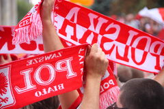 Fans. Polish fans with white and red scarves Royalty Free Stock Images
