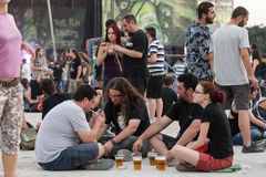 Fans. Sitting and drinking beer at rock festival. Photo taken at Tuborg Green Fest 2012 in Bucharest Stock Images