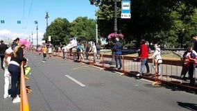 Fans applaud the runners of the St. Petersburg marathon. Runners hardly run a long distance. Fatigue after a long run.  stock video