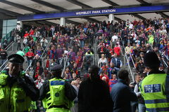 Fans arriving at the Wembley stadium in London. Fans of Barcelona and Manchester United arriving at the Wembley stadium in London, U.K. for the final of stock photo