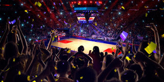 Fans on basketball court in game. Confetti and tinsel royalty free stock photos