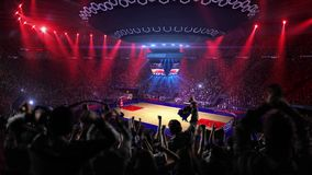 Fans on basketball court in game