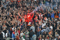 Fans burn fireworks in the stands Stock Photo