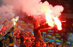 Fans burn flares during the football game Royalty Free Stock Images