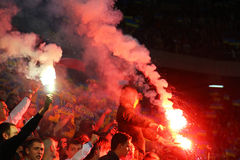 Fans burn flares during the football game stock image