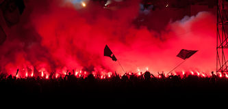 Fans burn flares at rock concert Royalty Free Stock Images