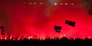 Fans burn flares at rock concert. Fans burn red flares at rock concert Stock Photo