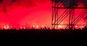 Fans burn flares at rock concert Stock Photos
