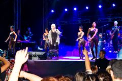 Fans cheer during the concert. Pop star Ajda Pekkan performs live during a concert at Maltepe on September 18, 2011 in Istanbul, Turkey. Concert stage on scene Royalty Free Stock Photos