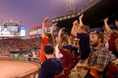 Fans cheer at historic Fenway Park Stock Photos
