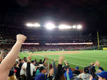 Fans cheer home team Mariners winning game. SEATTLE - JUNE 24: Fans cheer home team Mariners winning game at Safeco Field baseball game, Seattle in June 24, 2016 Stock Image