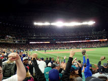 Fans cheer home team Mariners winning game. SEATTLE - JUNE 24: Fans cheer home team Mariners winning game at Safeco Field baseball game, Seattle in June 24, 2016 Stock Photography