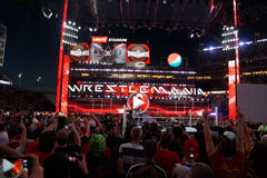 Fans cheer and record action on phones at close of Wrestlemania Stock Photo