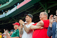 Fans cheer at a Red Sox game Royalty Free Stock Photo