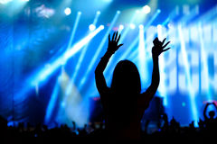 Fans cheering at open-air live concert. Royalty Free Stock Photos