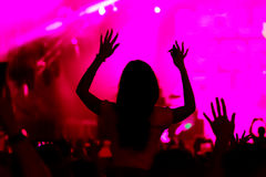 Fans cheering at open-air live concert. Royalty Free Stock Image