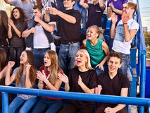 Fans cheering in stadium. Group people wait your favorite team. Fans cheering in stadium. Group people wait your favorite team and worry on tribunes. Youth royalty free stock photo
