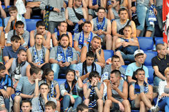 Fans of Chernomorets in vests watching the game Stock Image