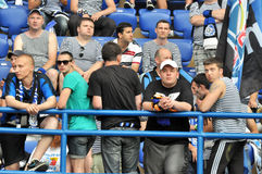 Fans of Chernomorets wearing vests Royalty Free Stock Images