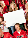 Fans: Cute Woman Holds Up Blank Sign Stock Photography